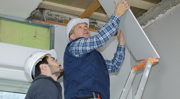 Workers repairing Drywall Damage